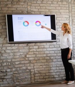 Business woman presenting with slide